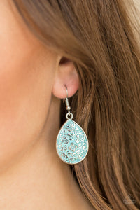 Featuring a refreshing blue backdrop, glistening floral filigree climbs a silver teardrop for a seasonal look. Earring attaches to a standard fishhook fitting.  Sold as one pair of earrings.  Always nickel and lead free.