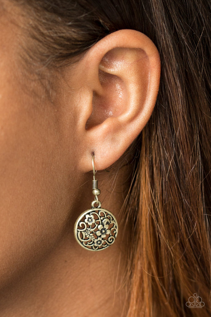 Glistening floral filigree blooms across a circular brass frame for a whimsical seasonal look. Earring attaches to a standard fishhook fitting.  Sold as one pair of earrings.  Always nickel and lead free.