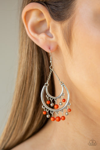 Dainty orange and silver beads swing from the top and bottom of a shimmery silver half-moon frame, creating a vivacious fringe. Earring attaches to a standard fishhook fitting.  Sold as one pair of earrings.  Always nickel and lead free
