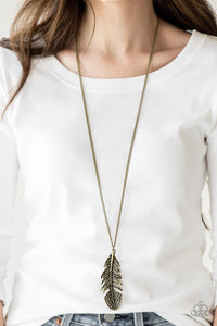 Featuring studded and antiqued textures, a dramatic brass feather pendant swings from the bottom of an elongated brass chain for a free-spirited fashion. Features an adjustable clasp closure.  Sold as one individual necklace. Includes one pair of matching earrings.   Always nickel and lead free.