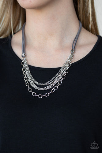 Suspended between strips of earthy gray suede, mismatched strands of silver layer below the collar for a spunky industrial look. Features an adjustable clasp closure.  Sold as one individual necklace. Includes one pair of matching earrings.  Always nickel and lead free