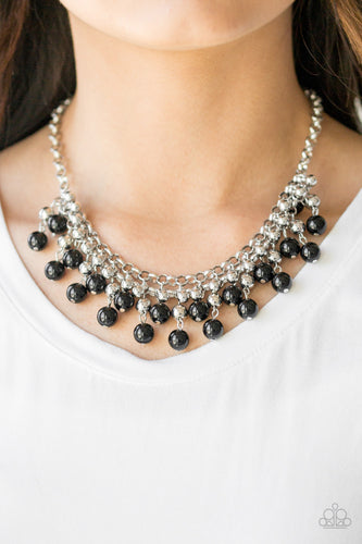 Rows of classic silver and shiny black beads trickle from two rows of interlocking silver chains, creating a bold colorful fringe below the collar. Features and adjustable clasp closure.  Sold as one individual necklace. Includes one pair of matching earrings.   Always nickel and lead free.