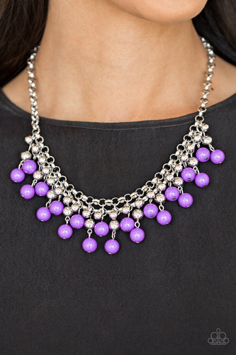 Rows of classic silver and vivacious purple beads trickle from two rows of interlocking silver chains, creating a bold colorful fringe below the collar. Features and adjustable clasp closure.  Sold as one individual necklace. Includes one pair of matching earrings.   Always nickel and lead free.