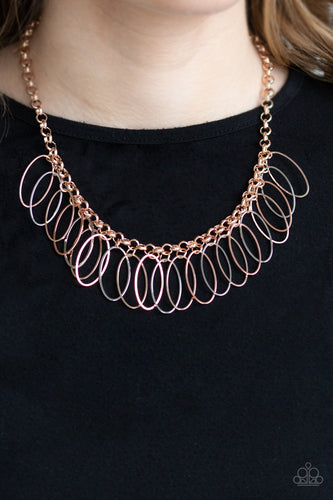 Oval shiny copper, rose gold, and silver frames dangle from a bold rose gold chain, creating a dizzying fringe below the collar. Features an adjustable clasp closure.  Sold as one individual necklace. Includes one pair of matching earrings.  Always nickel and lead free.