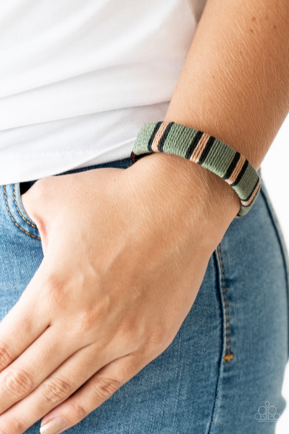 Earthy black, brown, and green thread winds around a brown leather band for a rustic look. Features an adjustable snap closure.  Sold as one individual bracelet.  Always nickel and lead free.