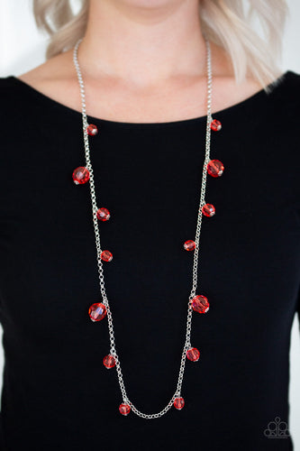 Varying in size, a collection of glassy red crystal-like beads trickle down a shimmery silver chain across the chest for a whimsical look. Features an adjustable clasp closure.  Sold as one individual necklace. Includes one pair of matching earrings.  Always nickel and lead free!