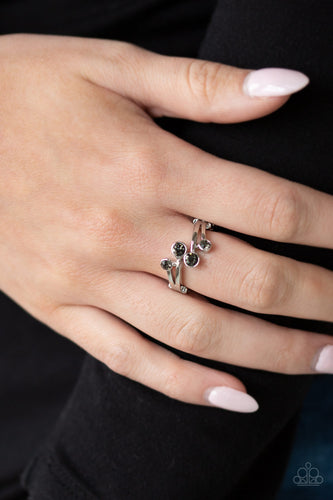 Dotted with smoky rhinestone ends, shiny silver bars fan across the finger. The dainty rhinestones collect at the center for a refined flair. Features a dainty stretchy band for a flexible fit.  Sold as one individual ring.  Always nickel and lead free.