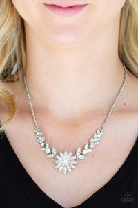 Encrusted in glassy white rhinestones, glittery leafy frames give way to a blooming silver frame encrusted in dazzling white rhinestones below the collar for a sparkling seasonal finish. Features an adjustable clasp closure.  Sold as one individual necklace. Includes one pair of matching earrings.  Always nickel and lead free.