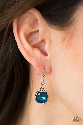 Chiseled into an alluring square style cut, a faceted blue gem is pressed into a serrated silver frame for a regal look. Earring attaches to a standard fishhook fitting.  Sold as one pair of earrings.  Always nickel and lead free.
