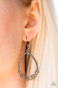 Airy geometric frames join at the bottom of an airy gunmetal lure, creating an edgy frame. Earring attaches to a standard fishhook fitting.  Sold as one pair of earrings.  Always nickel and lead free.
