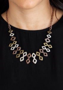 Brushed in an antiqued shimmer, glistening diamond-shaped copper, brass, and silver frames link below the collar, coalescing into an edgy geometric fringe. Features an adjustable clasp closure.  Sold as one individual necklace. Includes one pair of matching earrings.  Always nickel and lead free.