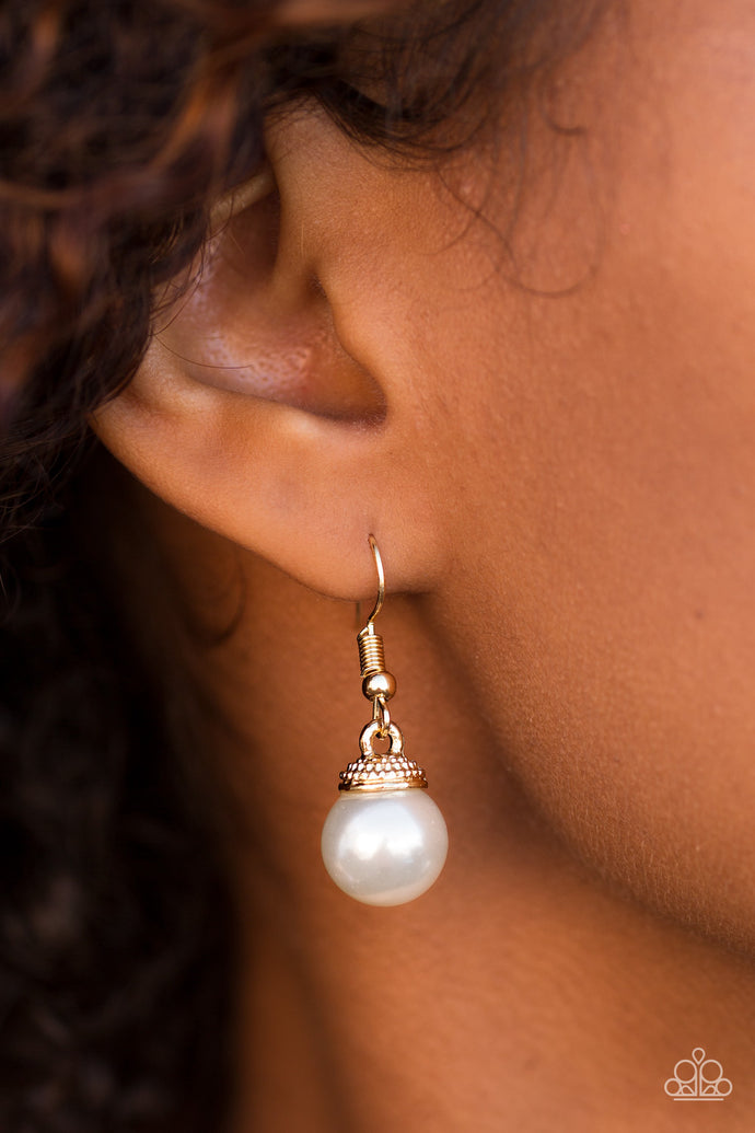 Capped in an ornate gold fitting, a solitaire white pearl swings from the ear in a timeless fashion. Earring attaches to a standard fishhook fitting.  Sold as one pair of earrings.  Always nickel and lead free.