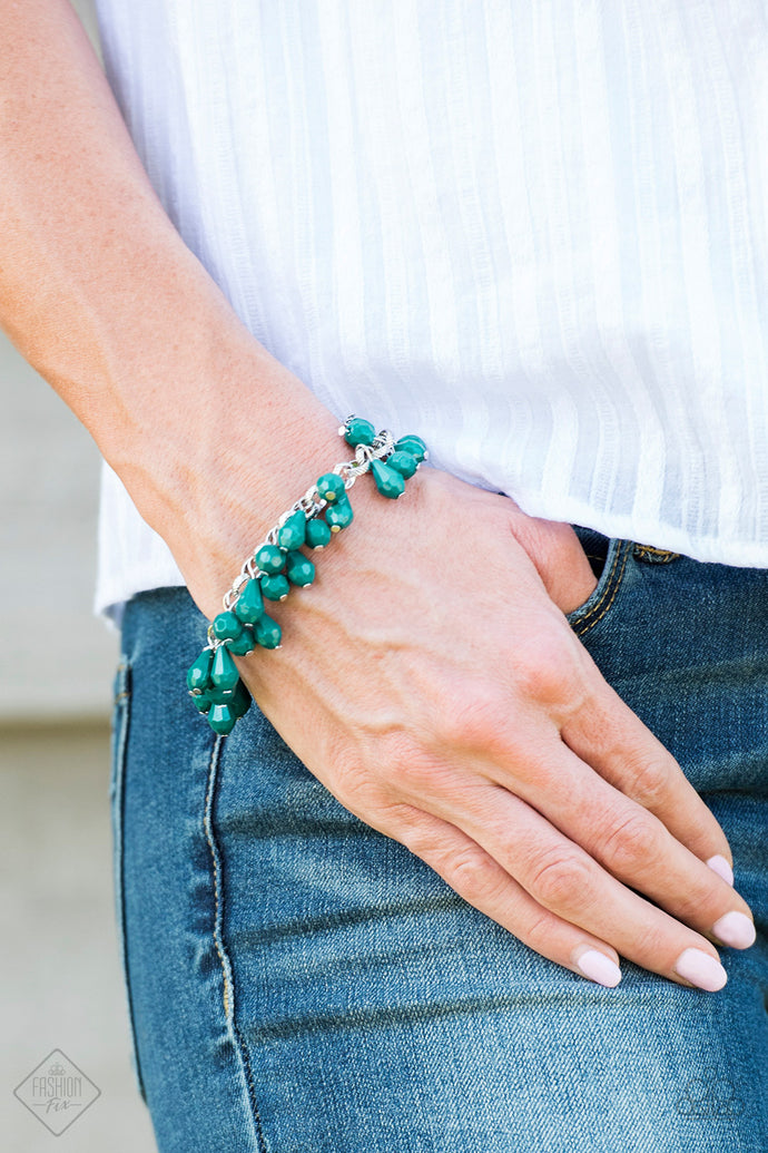 Featuring round and teardrop shapes, clusters of faceted Quetzal Green beads swing from a shimmery silver chain, creating a playful fringe around the wrist. Features an adjustable clasp closure.  Sold as one individual bracelet.   Glimpses of Malibu Fashion Fix September 2018  Always nickel and lead free.