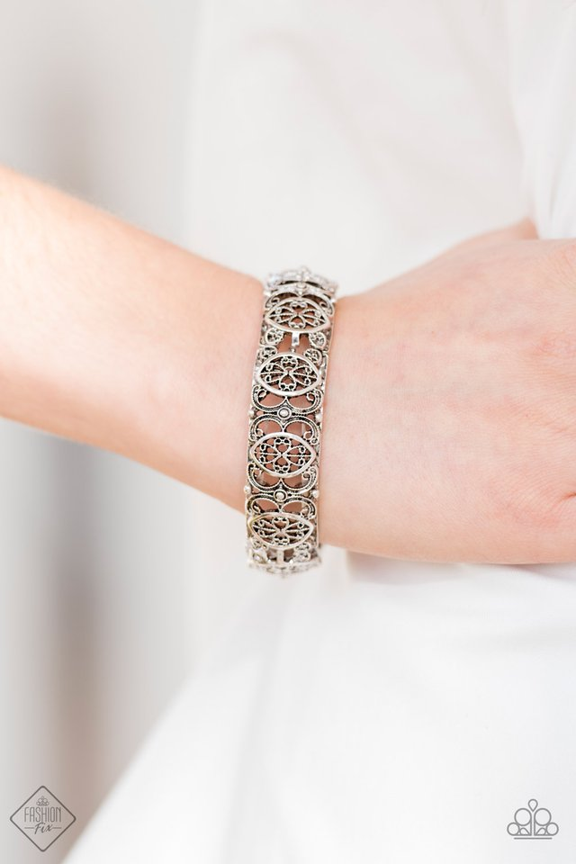 Brushed in an antiqued shimmer, ornate silver frames are threaded along elastic stretchy bands and linked around the wrist for a tribal inspired look.  Sold as one individual bracelet.  Always nickel and lead free.