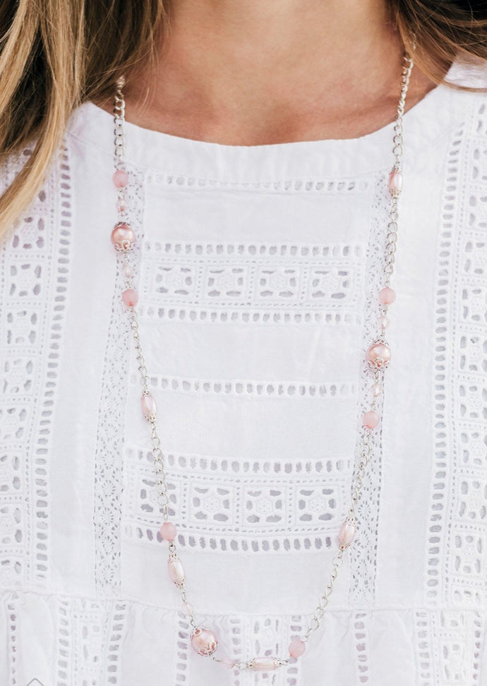 Pearly Blooming Dahlia, faceted and opaque crystal-like beads trickle along an elegantly elongated silver chain for a refined look. Features an adjustable clasp closure.  Sold as one individual necklace. Includes one pair of matching earrings.   Glimpses of Malibu Fashion Fix   Always nickel and lead free.