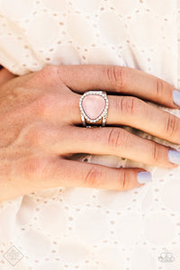 Featuring an opaque shimmer, a glassy pink gem is pressed into a sleek silver frame encrusted in dainty white rhinestones for a whimsical look. Features a stretchy band for a flexible fit.  Sold as one individual ring.  Always nickel and lead free.