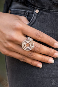 Pinched between two shiny silver fittings, shimmery textured hoops radiate into a dizzying frame atop the finger. Features a stretchy band for a flexible fit.   Glimpses of Malibu Fashion Fix  December 2018  Always nickel and lead free.