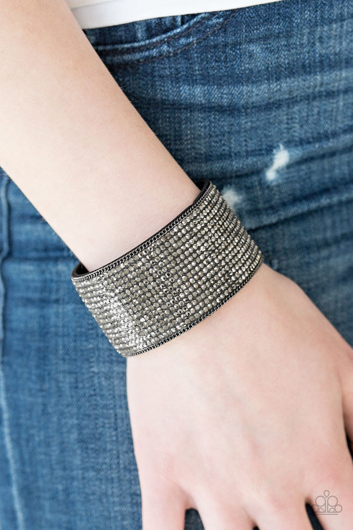 Row after row of glittery hematite rhinestones are encrusted along a thick black suede band, creating blinding shimmer across the wrist. Features an adjustable snap closure.  Sold as one individual bracelet.   Always nickel and lead free.