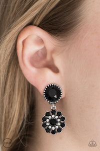 Dainty black and white rhinestones bloom into a romantic floral frame. The glittery frame swings from the bottom of a faceted black gem for an elegant finish. Earring attaches to a standard clip-on fitting.  Sold as one pair of clip-on earrings.  Always nickel and lead free.
