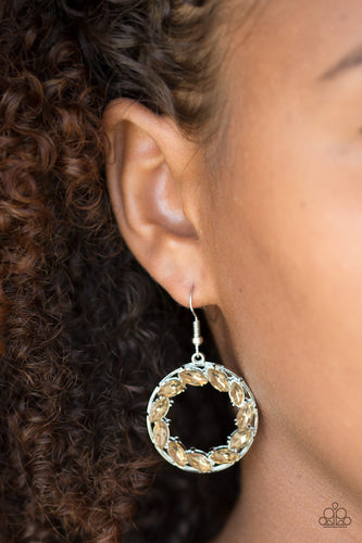 Featuring regal marquise style cuts, glittery topaz rhinestones are encrusted along a shimmery silver hoop for a radiant fashion. Earring attaches to a standard fishhook fitting.  Sold as one pair of earrings.  Always nickel and lead free.