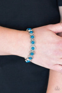 Dotted with refreshing blue beaded centers, studded silver frames are threaded along stretchy elastic bands and linked around the wrist for a whimsical look.  Sold as one individual bracelet.  Always nickel and lead free.