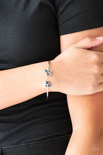 Varying in shape, glittery blue and white rhinestones join at both ends of a dainty silver cuff, creating refined fittings.  Sold as one individual bracelet.  Always nickel and lead free.