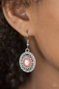A pearly orange bead is pressed into the center of an ornate silver frame radiating with glassy white rhinestones for a regal look. Earring attaches to a standard fishhook fitting.  Sold as one pair of earrings.  Always nickel and lead free.