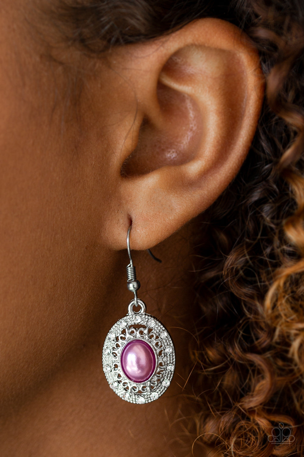 A pearly purple bead is pressed into the center of an ornate silver frame radiating with glassy white rhinestones for a regal look. Earring attaches to a standard fishhook fitting.  Sold as one pair of earrings.  Always nickel and lead free.