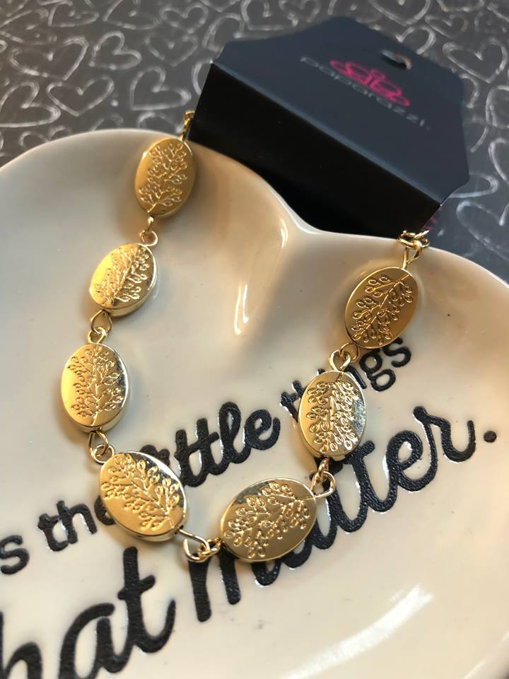 Stamped in a leafy tree pattern, shiny gold beads link around the wrist in a whimsical fashion. Features an adjustable clasp closure.  Sold as one individual bracelet. Always nickel and lead free.