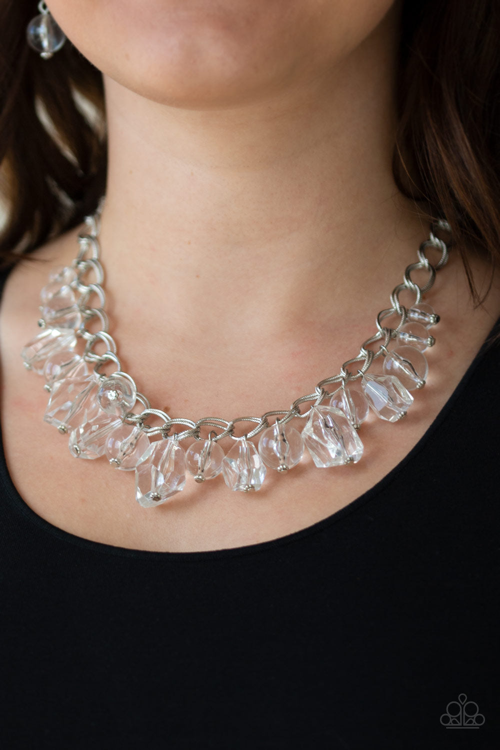 Varying in shape and shimmer, smooth and faceted glassy beads trickle from doubled silver chain links, creating a glamorous fringe below the collar. Features an adjustable clasp closure.  Sold as one individual necklace. Includes one pair of matching earrings.  Always nickel and lead free.