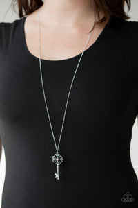 Dotted with a glittery pink rhinestone, a vintage inspired key pendant swings from the bottom of an elegantly elongated silver chain for a whimsical look. Features an adjustable clasp closure.  Sold as one individual necklace. Includes one pair of matching earrings.  Always nickel and lead free.
