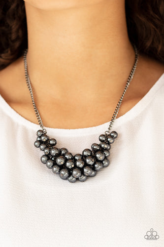 A collection of pearly gunmetal beads dangle from the bottom of a glistening gunmetal chain, creating a glamorously clustered display below the collar. Features an adjustable clasp closure.  Sold as one individual necklace. Includes one pair of matching earrings. Always nickel and lead free.