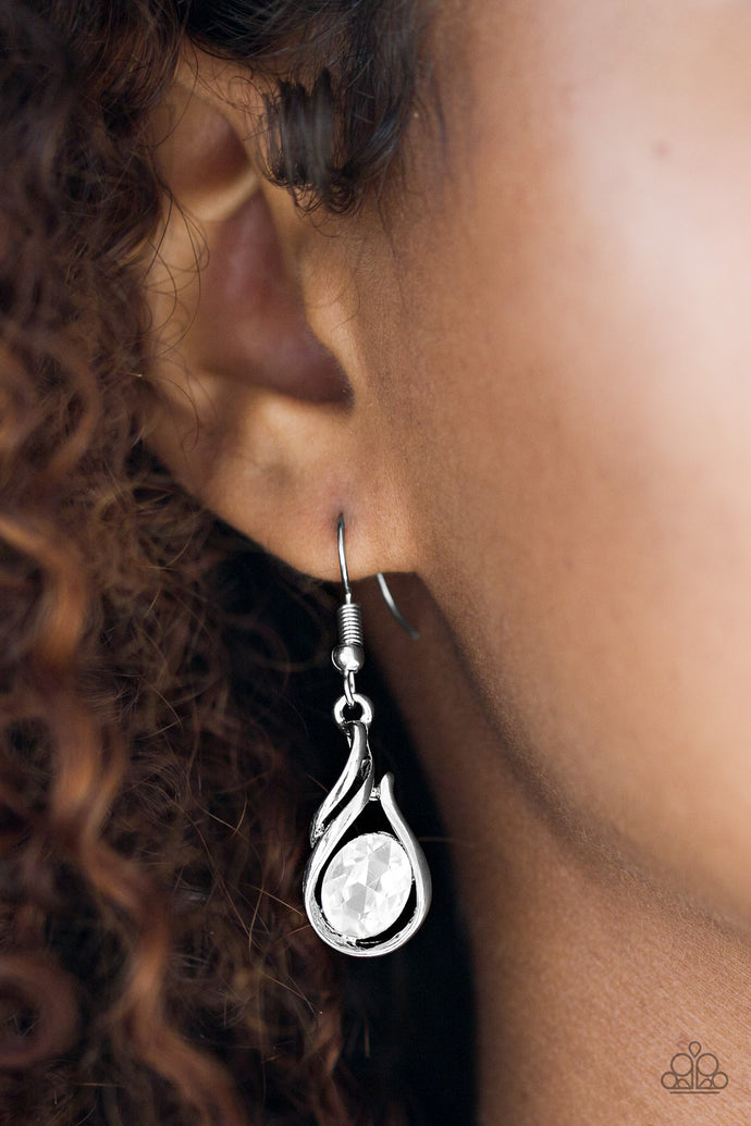 Moving in flame-like patterns, glistening silver bars enwrap around a tilted oval rhinestone, creating a refined lure. Earring attaches to a standard fishhook fitting.  Sold as one pair of earrings.  Always nickel and lead free.
