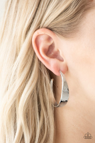 Delicately hammered in shimmery textures, a thick silver hoop curls around the ear for a casual look. Earring attaches to a standard post fitting. Hoop measures 1 3/4
