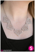 Load image into Gallery viewer, Shimmery metallic plates swing from a classic silver chain, creating a geometric fringe. Decorated in a Southwestern textile pattern, the stenciled plates fall just below the collar in an airy fashion. Features an adjustable clasp closure.  Sold as one individual necklace. Includes one pair of matching earrings.  Always nickel and lead free.