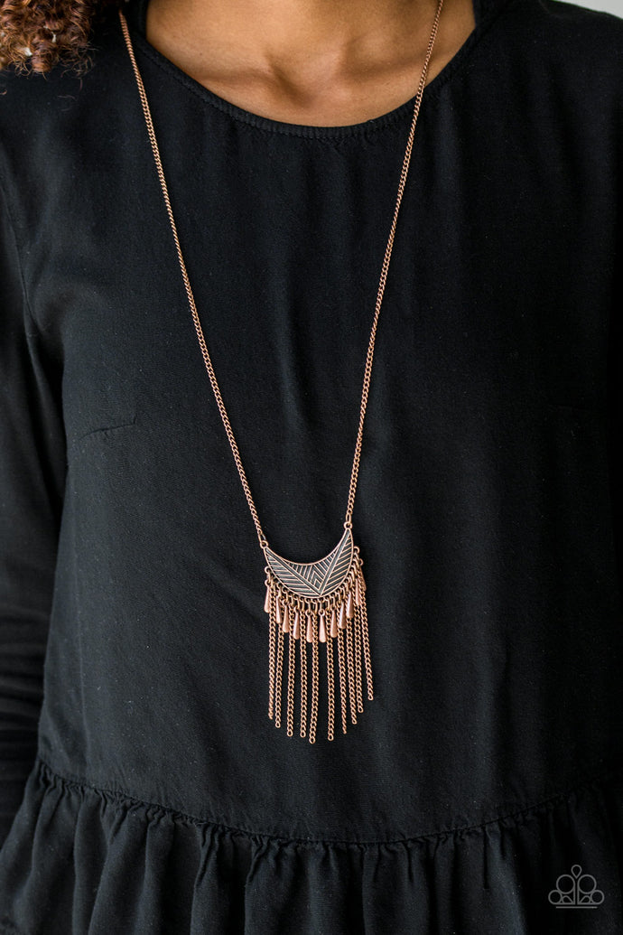 Radiating in linear textures, a glistening copper crescent swings from the bottom of a lengthened copper chain. Shimmery copper chains and flared copper beading swings from the bottom of the tribal inspired pendant, creating a flirtatious fringe. Features an adjustable clasp closure.   Sold as one individual necklace. Includes one pair of matching earrings.  Always nickel and lead free.