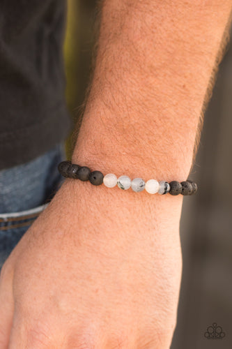 Essential Oil Alert!! Glassy white and earthy black lava stones are threaded along a stretchy elastic band for a seasonal look.  Sold as one individual bracelet.  Always nickel and lead free.
