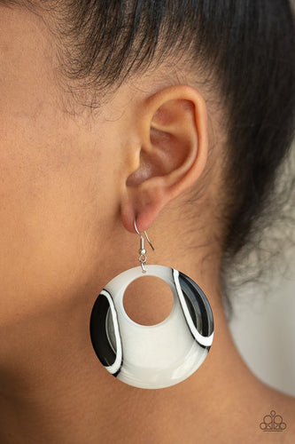 Swirling with dizzying black and white detail, a shiny acrylic hoop swings from the ear for a retro look. Earring attaches to a standard fishhook fitting.  Sold as one pair of earrings.  Always nickel and lead free.  Life of the Party Exclusive August 2019
