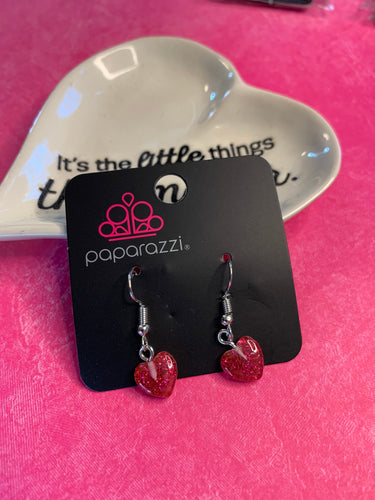 Darling sparkling hearts gracefully fall from the ear.  Earring attaches to a standard fishhook fitting.  Sold as one pair of earrings.  Always nickel and lead free.