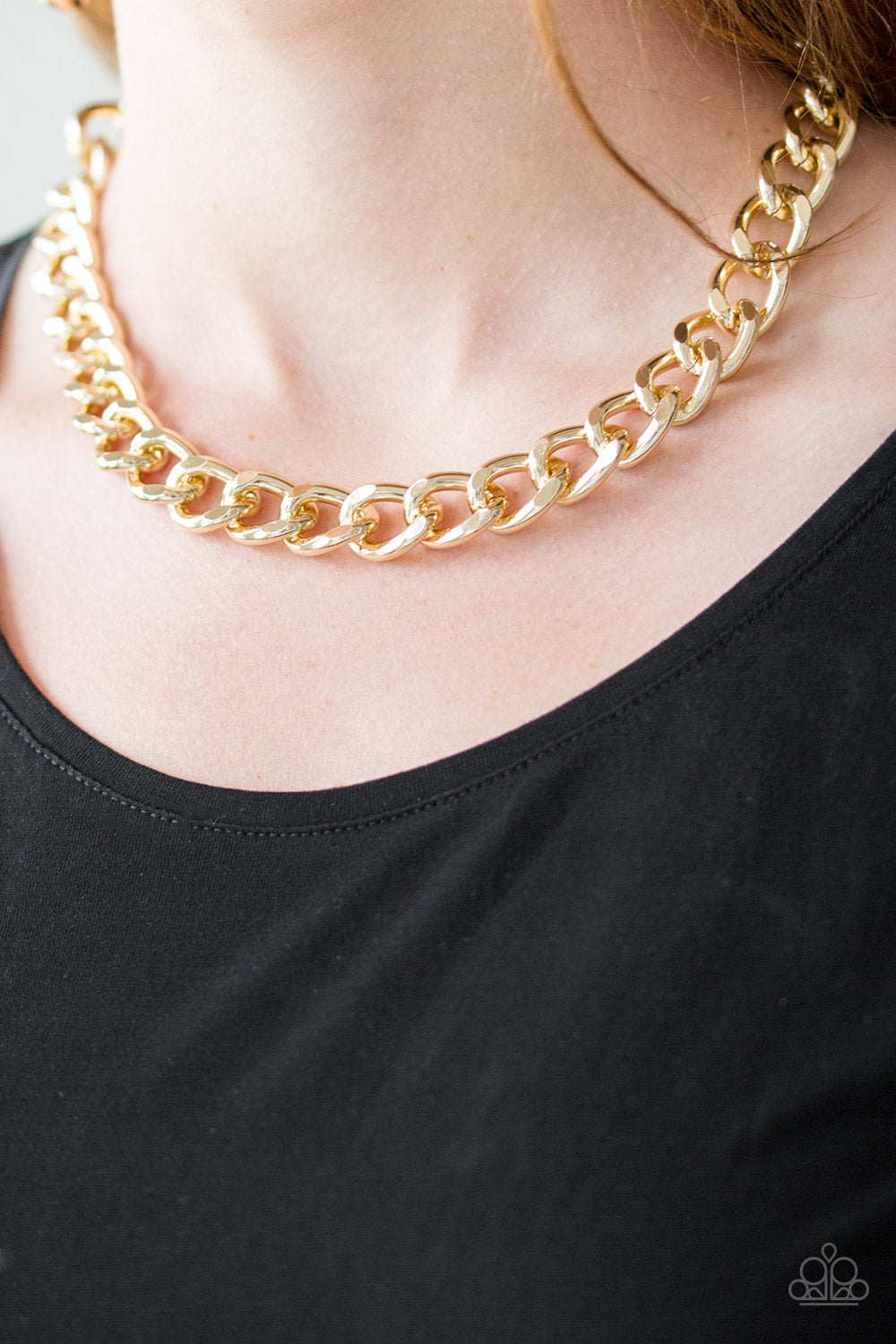 Brushed in a high-sheen shimmer, a bold gold chain drapes below the collar in an edgy industrial fashion. Features an adjustable clasp closure.  Sold as one individual necklace. Includes one pair of matching earrings.