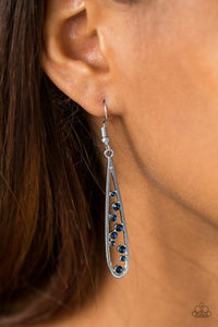 Dainty blue rhinestones tumble down the center of a shimmery silver teardrop, creating an elegant lure. Earring attaches to a standard fishhook fitting.  Sold as one pair of earrings.   Always nickel and lead free