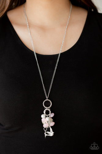 A silver bird charm, silver heart charms, and collection of white pearls and opaque pink crystal-like beads swing from the bottom of a lengthened silver chain for a whimsically clustered look. Features an adjustable clasp closure.  Sold as one individual necklace. Includes one pair of matching earrings.  Always nickel and lead free.