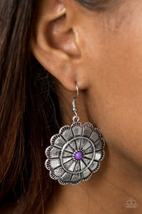 Shimmery silver petals bloom from a vivacious purple center for a seasonal look. Etched in serrated edges, alternating petals have been delicately hammered in texture, adding depth and shimmer to the whimsical frame. Earring attaches to a standard fishhook fitting.  Sold as one pair of earrings.  Always nickel and lead free.