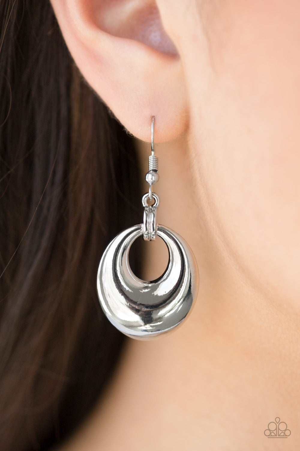 Brushed in a high-sheen finish, a silver frame swings from glistening silver fittings for a casual look. Earring attaches to a standard fishhook fitting.  Sold as one pair of earrings.  Always nickel and lead free