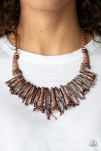 Brushed in an antiqued shimmer, a collision of glistening copper bars and hammered copper accents coalesce into an abstract statement piece below the collar for a fierce industrial look. Features an adjustable clasp closure.  Sold as one individual necklace. Includes one pair of matching earrings.  Always nickel and lead free.