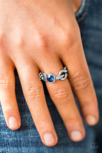 Dotted with a glittery blue rhinestone, a shiny silver bar loops into a whimsical infinity symbol across the finger, creating a dainty band. Features a dainty stretchy band for a flexible fit.  Sold as one individual ring.  Always nickel and lead free.