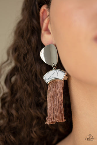 A plume of shiny brown thread streams from the bottom of a white stone frame that links with an asymmetrical silver disc, creating flirtatious tassel. Earring attaches to a standard post fitting.  Sold as one pair of post earrings. Always nickel and lead free.