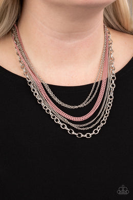 Painted in a colorful finish, shiny pink chains join a collision of silver chains below the collar for a daring industrial look. Features an adjustable clasp closure.  Sold as one individual necklace. Includes one pair of matching earrings.  Always nickel and lead free.