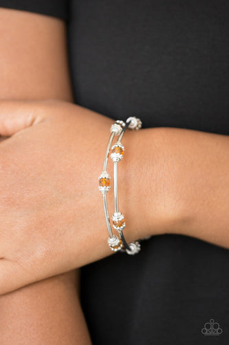 Dainty orange crystal-like beads and shimmery silver accents alternate along a coiled wire to create a refined infinity wrap style bracelet.  Sold as one individual bracelet.  Always nickel and lead free.