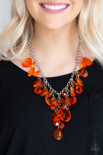 Glassy orange teardrops and glassy orange beads swing from the bottom of a shimmery silver chain. Matching beads trickle down free-falling chains, creating a glamorous fringe below the collar. Features an adjustable clasp closure.  Sold as one individual necklace. Includes one pair of matching earrings